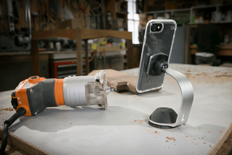 Graphic image of MagicMount Pro phone mount on workshop table
